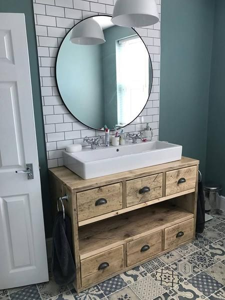 wooden vanity unit with two basins in bathroom