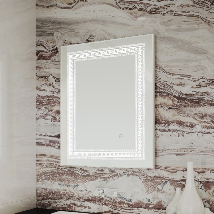 Lifestyle image of Bathroom Origins Athenian Mirror with a patterned feature wall background and decorative ornaments