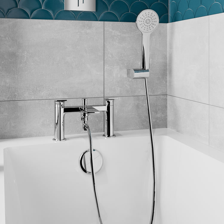 Photo of the Greenwich 2TH Bath Shower Mixer in Chrome with light grey and blue tiles