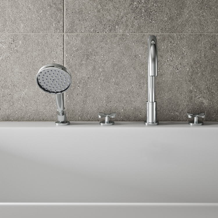 Closeup image of Burlington Riviera 4 Tap Hole Bath Shower Mixer with Handset in bathroom with grey tiled background