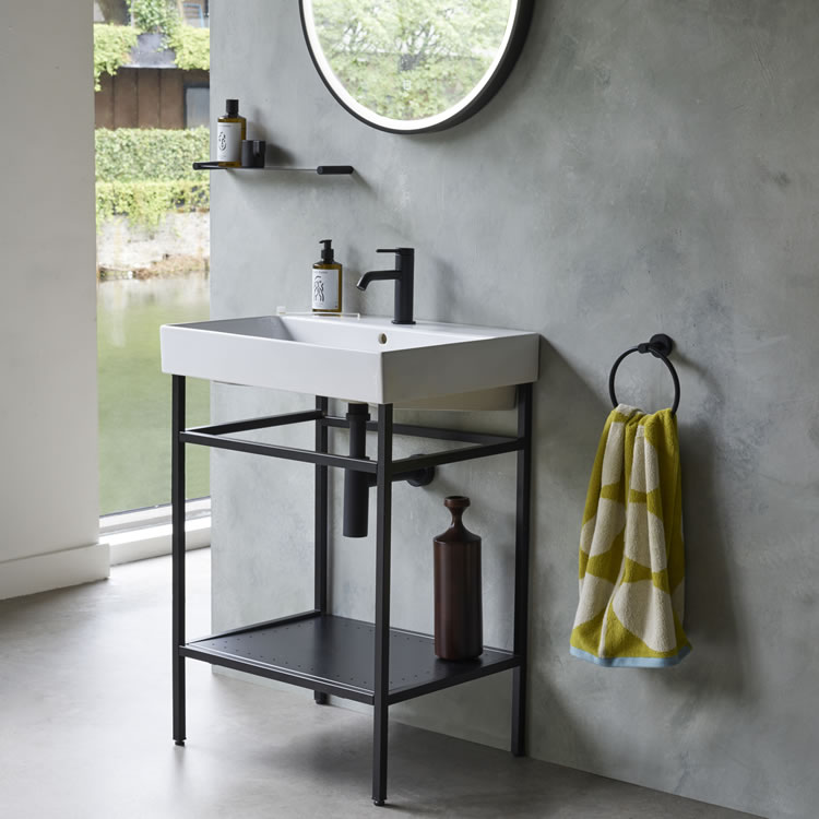 Photo of the Shoreditch Frame Furniture Stand in Matt Black with cement-effect wall
