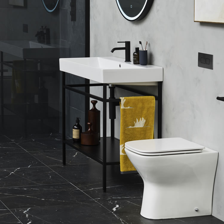 Photo of the Shoreditch Frame 700mm Furniture Stand in Matt Black with matt black accessories and black marble floor tiles