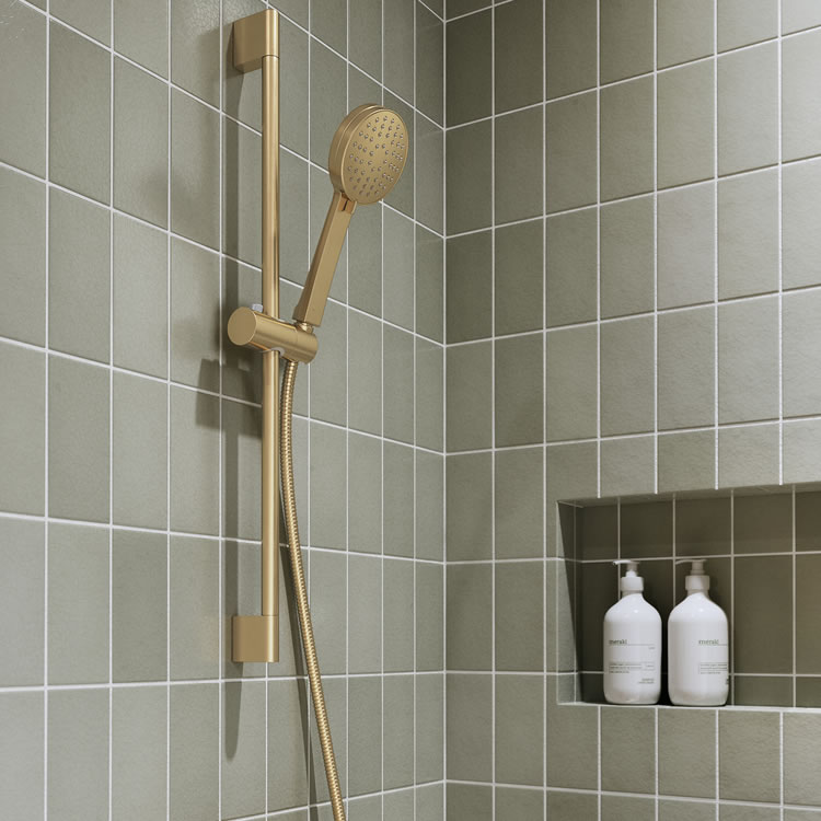 Photo of the Hoxton Shower Set with Outlet Elbow in Brushed Brass with a light green tiled wall
