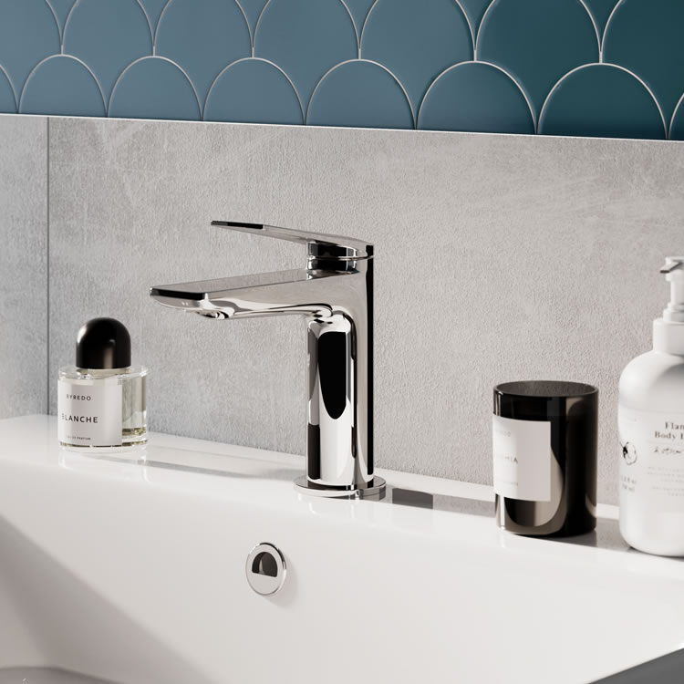 Britton Bathrooms Greenwich Basin Mixer in Chrome with light blue tiled wall