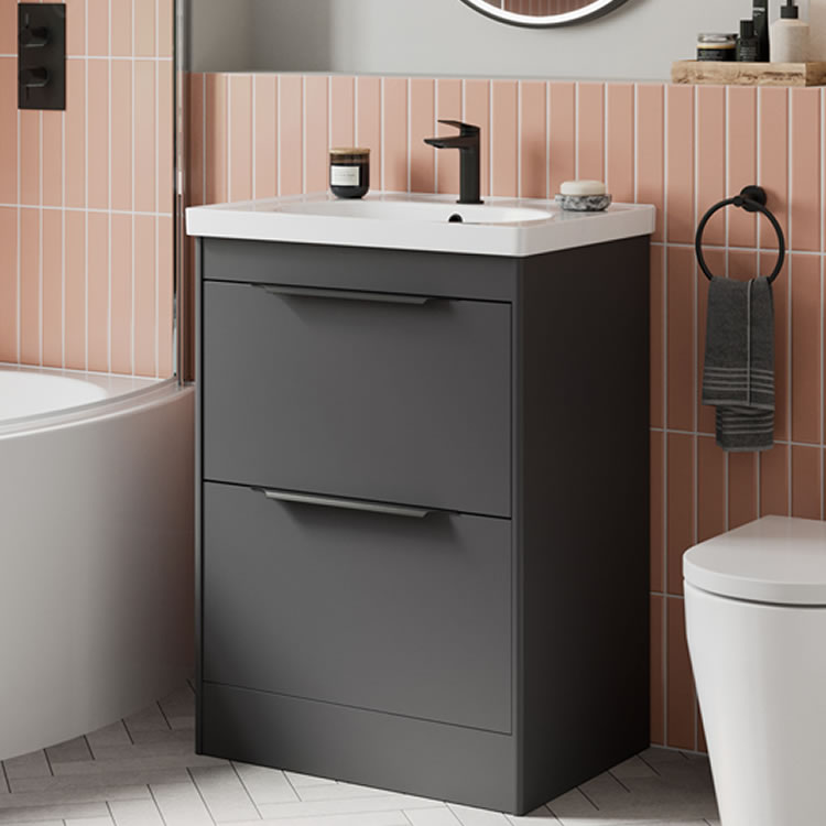Photo of the Shoreditch Floorstanding Double Drawer Unit in Matt Grey with matt black handles and pink tiled wall